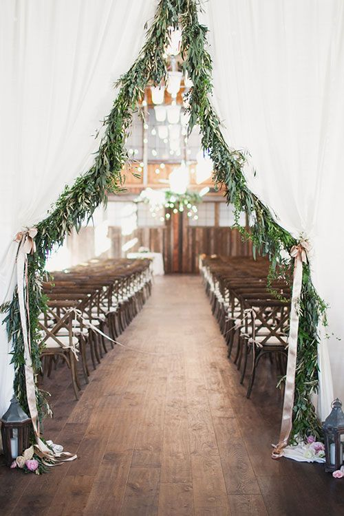 Ceremony Entrance with Greenery | Brides.com