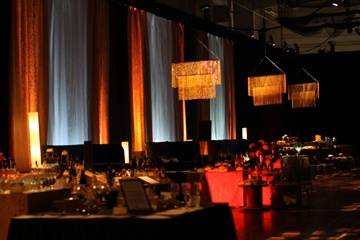 The amber chandeliers were an incredible glow in an often overlooked warm tone for events and were highlighted with 18 ft faux windows created with sheer and pin tucked fabric and lighting.