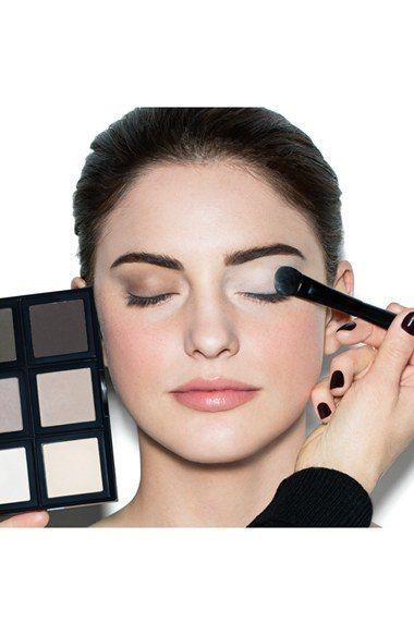 To create a clean slate for other shadows, apply a light shadow color from your lashline to your brow bone as a base. Dark shades of powder eyeshadow can be used with an eyeliner brush to line your eyes. Light, shimmery shades can be applied to the inner corner of the eye or on the brow bone as a subtle highlight. Avoid eyeshadows with red or purple undertones if you have redness around the eyes, as these colors will make your eyes look tired. Stick with neutral, brown or grey colors.