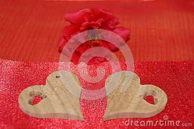 Wooden hearts on red background
