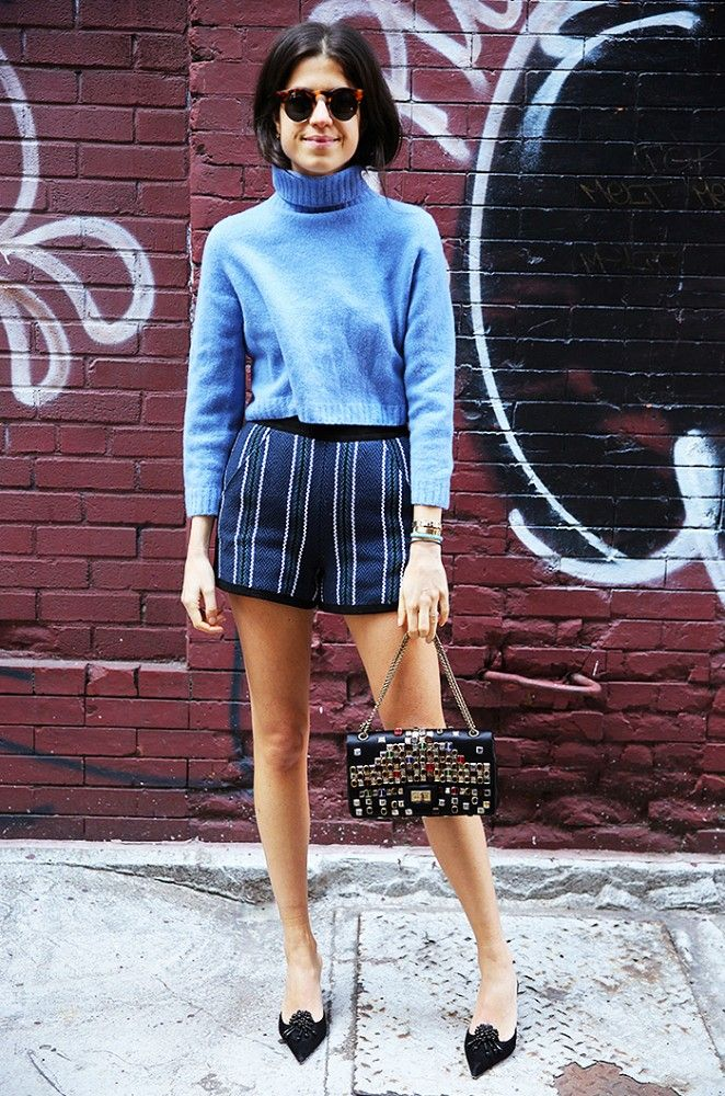 Blue cropped sweater, striped shorts, and point-toe heels