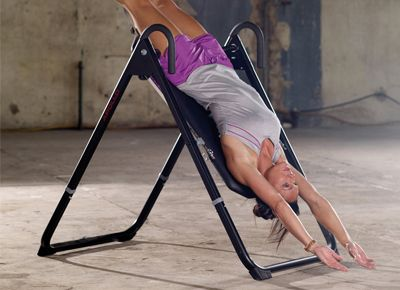 hanging upside down chair for back pink rolling the benefits of sweat inversion table fitness therapy