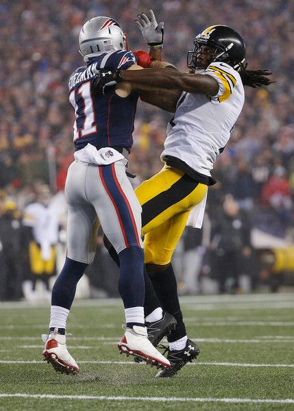 Julian Edelman Photos Photos - Julian Edelman #11 of the New England Patriots and Antonio Brown #84 of the Pittsburgh Steelers become tangled up during the first quarter in the AFC Championship Game at Gillette Stadium on January 22, 2017 in Foxboro, Massachusetts. - AFC Championship - Pittsburgh Steelers v New England Patriots