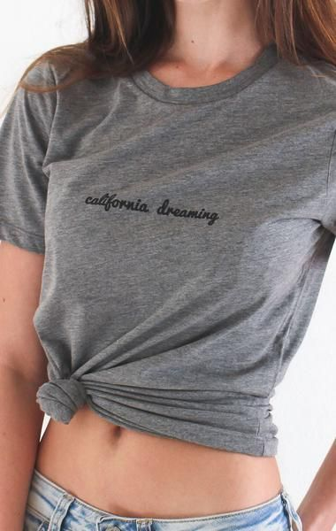 "- Description Details: Relaxed tee in grey with print 'California Dreaming'. Brand: NYCT Clothing. Relaxed fit. 50% Polyester 25% Cotton 25% Rayon. Imported. Measurements: (Size Guide) S: 37"" bust, 25"