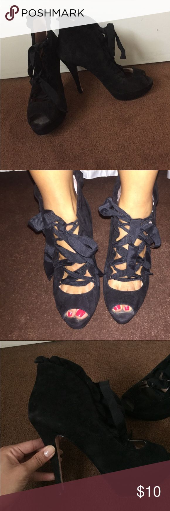 """Betsey Johnson Shoe Super girly sueded heel with peep toe, ribbon laces, and ruffle trim. 4"""" heel with 1"""" platform. I added a foot padding to these puppies because they were too big for me and my foot was sliding in em but I had to have them!😬 Damage on right bottom heel, was meaning to take it to shoe repair but never got around to it. Priced accordingly. Betsey Johnson Shoes Heels"""