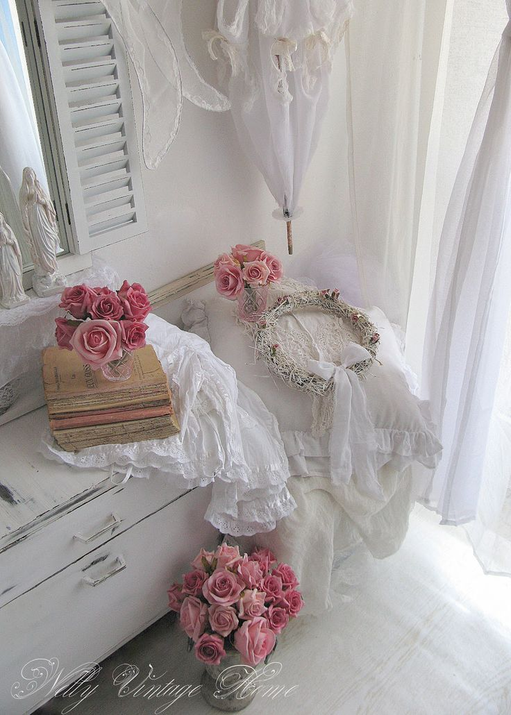 The white with the splashes of pink roses is lovely