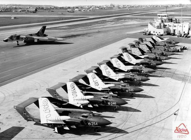 A daily airshow! A Vulcan bomber prepares to take off from RAF Luqa as aircraft from HMS Hermes sit on the tarmac in July 1970