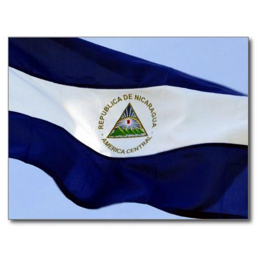 Nicaragua flag.  Blue stripes represent the Pacific Ocean and Caribbean Sea.  White stripe symbolizes peace.