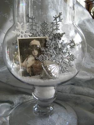Epsom salt, snowflakes, and a vintage photo in an apothecary jar