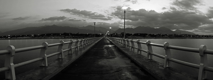 Highway to the mountains (Forte dei Marmi's pier viewed during the early morning lights)