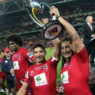 Anthony and Saia Faainga celebrate the Queensland Reds Super 15 championship - Raidke Samo in the background