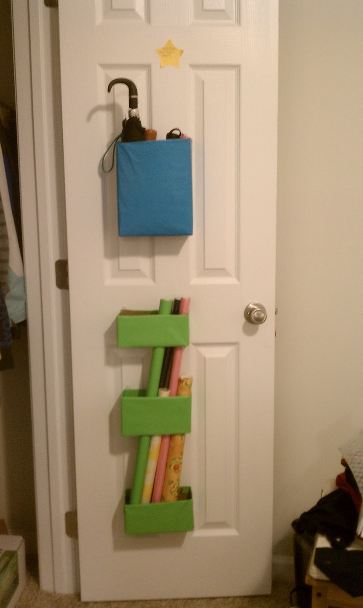 Cereal boxes on back of door as wrapping paper holder