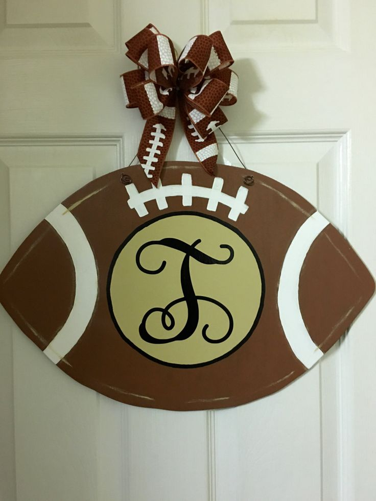 Monogram Football Door Hanger by CountryBumpkinsSC on Etsy https://www.etsy.com/listing/475721167/monogram-football-door-hanger