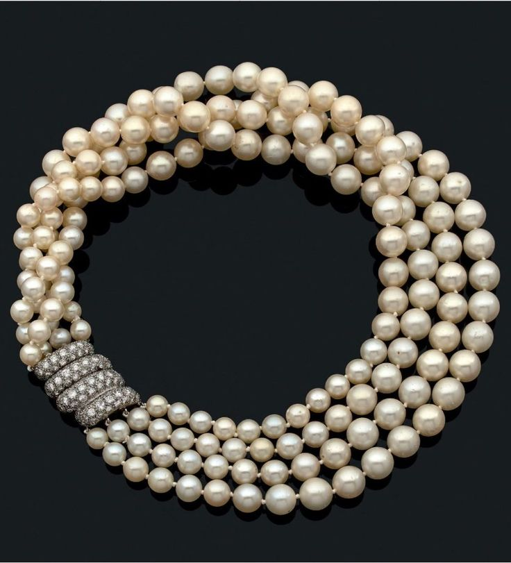 A vintage pearl necklace, by Suzanne Belperron, pre 1965. Designed as four rows of pearls with a platinum 'wave' clasp pavé-set with diamonds. With marker's mark for Darde et Fils. #SuzanneBelperron #vintage necklace