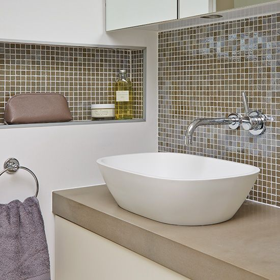 Modern bathroom with mosaic tiled splashback and basin