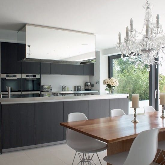This Weeks Room Of The Week Is A Glamorous Kitchen Diner From House To Home Gallery Combines Practical With High End Chandelier