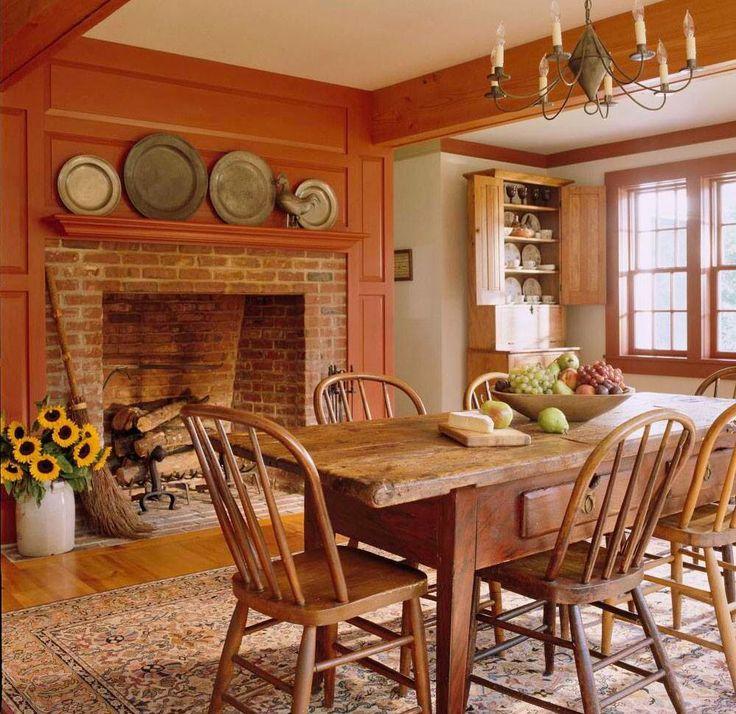Dining room decor wood & orange wall
