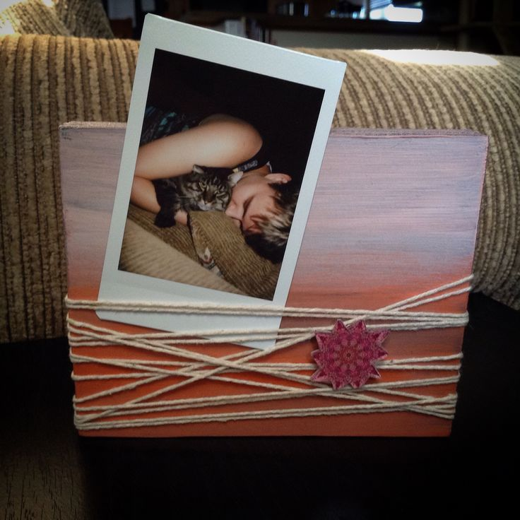 Alyice Edrich - Circa 2016 - Polaroid picture holder made from scrap wood, string, acrylic paint. Photo of girl used with permission.