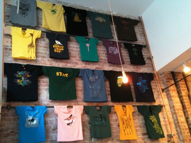 T-shirts displayed in the new Oaklandish store.