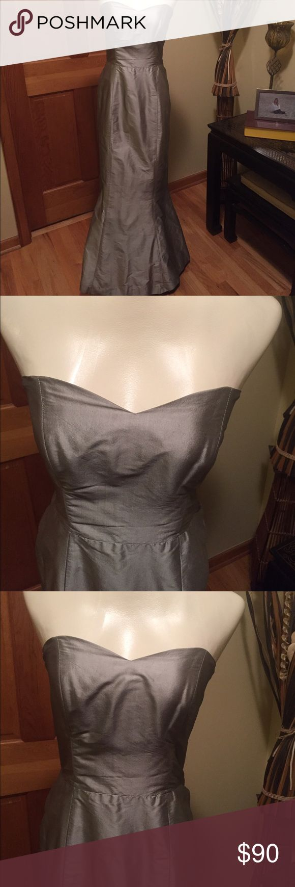 """❤️💋❣️Gorgeous Coren Moore formal dress Coren Moore formal gown - fitted mermaid style - silver/gray color. Strapless and flattering. Recently cleaned - small spot on the end of the dress that was noticed after cleaning. Not noticeable at all when worn. Other than that - dress is in excellent beautiful condition. Dress has been hemmed - not professionally. Price reflects flaw.  Breast approx 32"""" - waist approx 28"""" - hips approx 38"""" and length approx 52"""" Coren Moore Dresses Strapless"""