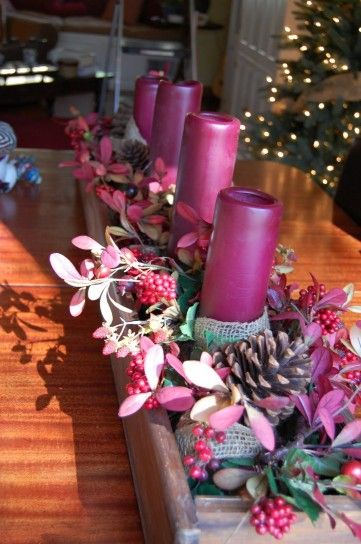 Centrotavola natalizi candele rosa