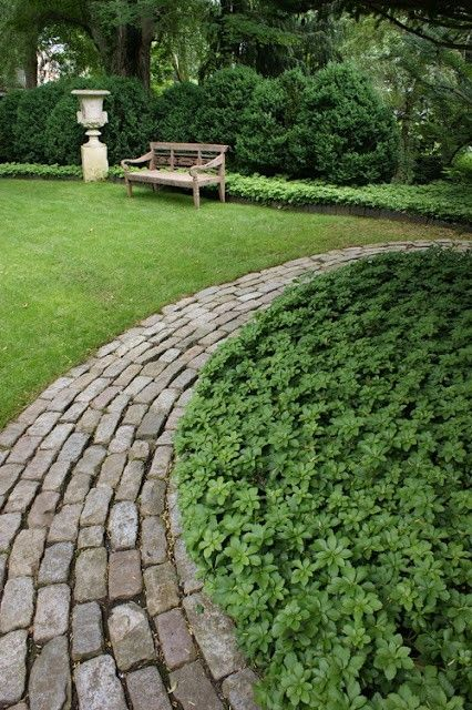 Brick walkway and ground cover Local red brick border for