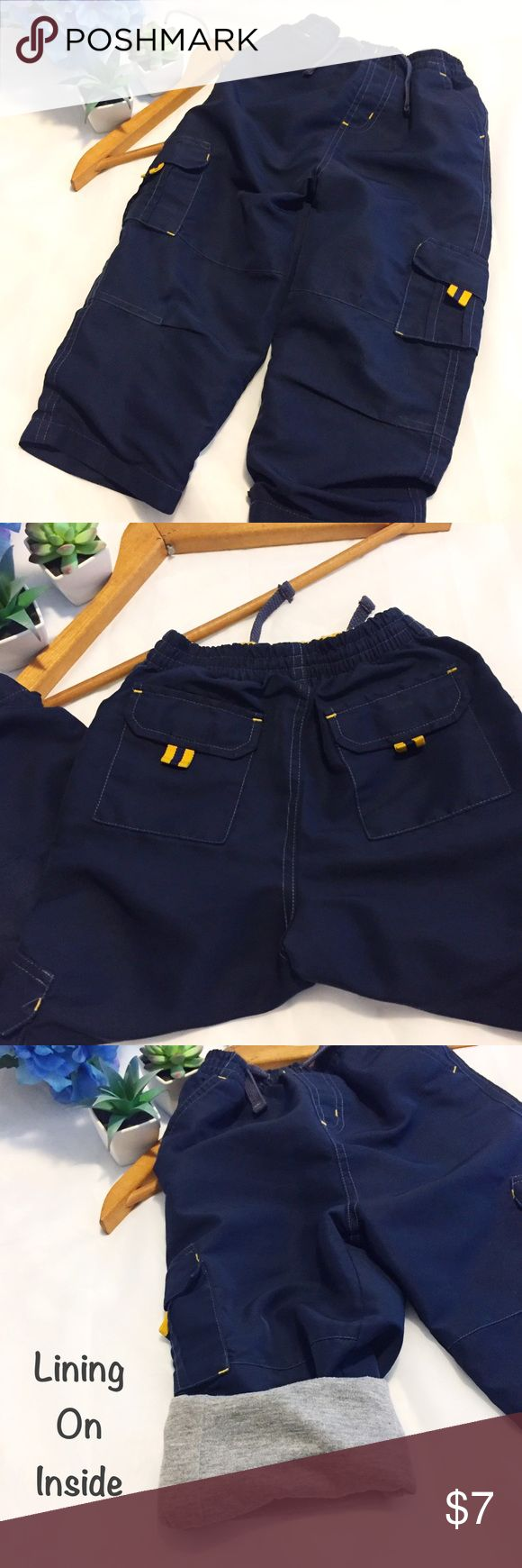"Athletic Works | Boys' Cargo Pants w/Lining Athletic Works | Boys' Cargo Pants with lining | Navy Blue & Yellow | Good used condition-small signs of wear; please see pics | Size 4T | Shell: 100% Polyester | Lining: 80% Polyester & 20% Cotton | Flat lay measurements: 8.5"" waist; 14"" inseam. Reasonable offers considered. 🚫trades/offline transactions. 🛍Bundle to save 10% • 3+ items. Thank you🌷 Athletic Works Bottoms Casual"
