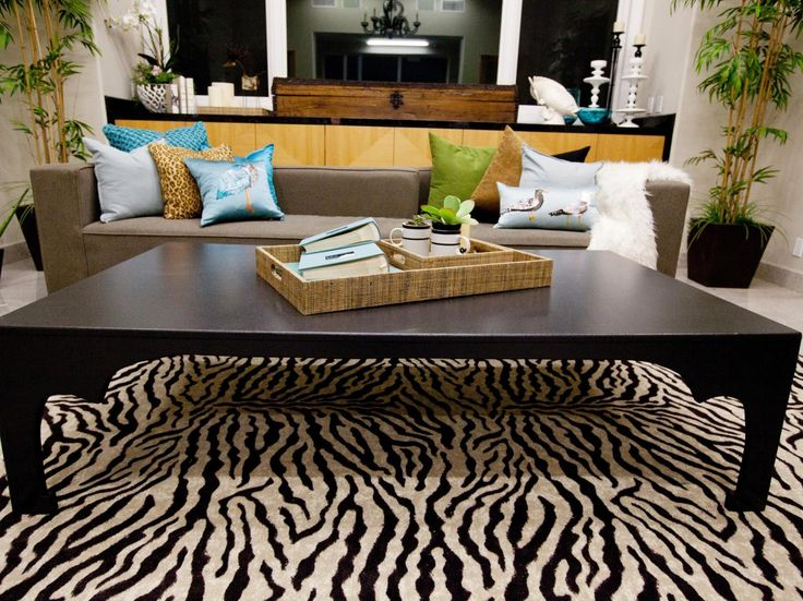 A bold striped rug adds visual interest to this living room, while clean-lined furnishings keep the space feeling sleek and modern.