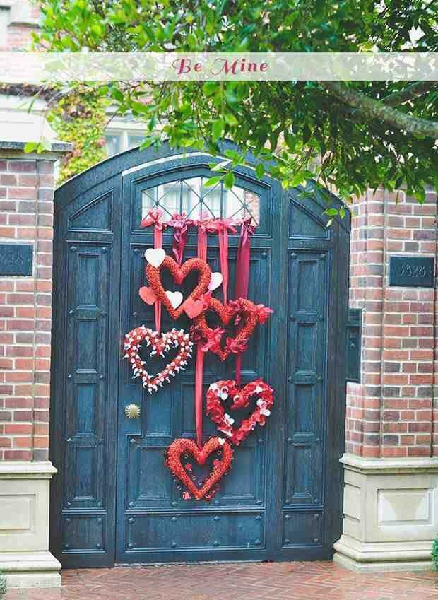 """Neat idea for a larger door (or scale it down for a smaller one). Hang small heart """"wreaths"""" from string at different levels."""