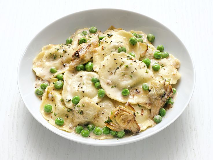 Get this all-star, easy-to-follow Ravioli Alfredo with Artichokes recipe from Food Network Kitchen