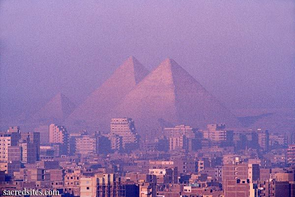 Pyramids of Giza, soaring above the city of Cairo, Egypt. The Great Pyramid of Giza is the most substantial ancient structure in the world - and the most mysterious. According to prevailing archaeological theory - and there is absolutely no evidence to confirm this idea - the three pyramids on the Giza plateau are funerary structures of three kings of the fourth dynasty (2575 to 2465 BC).