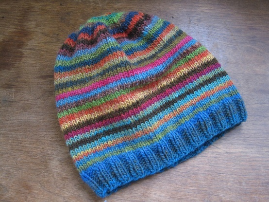 """CO 92 and then k2,p2 for 1.5"""". Increase row to add additional 4 stitches. Changed colors every 2 rounds and knit in pattern for about 8 inches. Decreased every other row until there were 10 stitches remaining. Cut thread and closed the crown.."""