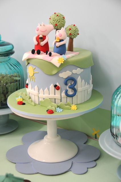 What a darling cake from a Peppa Pig party!  See more party ideas at CatchMyParty.com!  #partyideas #peppapig