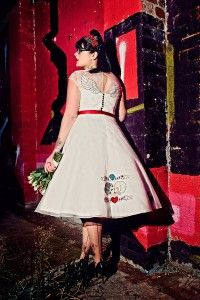The couture company alternative bespoke custom made wedding quirky dresses rockabilly 1950s tea length swing vintage red black tattoo tattooed bride embroidered embroidery - Photo by Steve Gerrard Photography