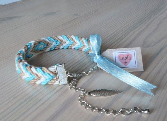 Braided bracelet ply split braiding aqua charm.  Gevlochten armband wit, beige en aqua met bedel