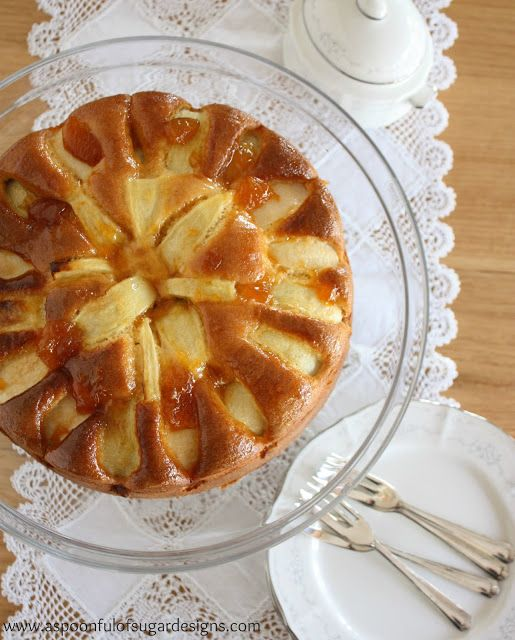 Apple Yoghurt Cake is a low fat recipe that uses yoghurt in place of butter/oils. Decorated with apple pieces and glazed with apricot jam, it is delicious.