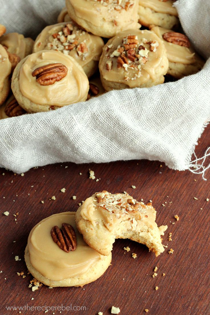 Brown Sugar Pecan Cookies: soft, moist pecan cookies topped with an easy brown sugar frosting. Perfect for Christmas or holiday baking!  www.thereciperebel.com