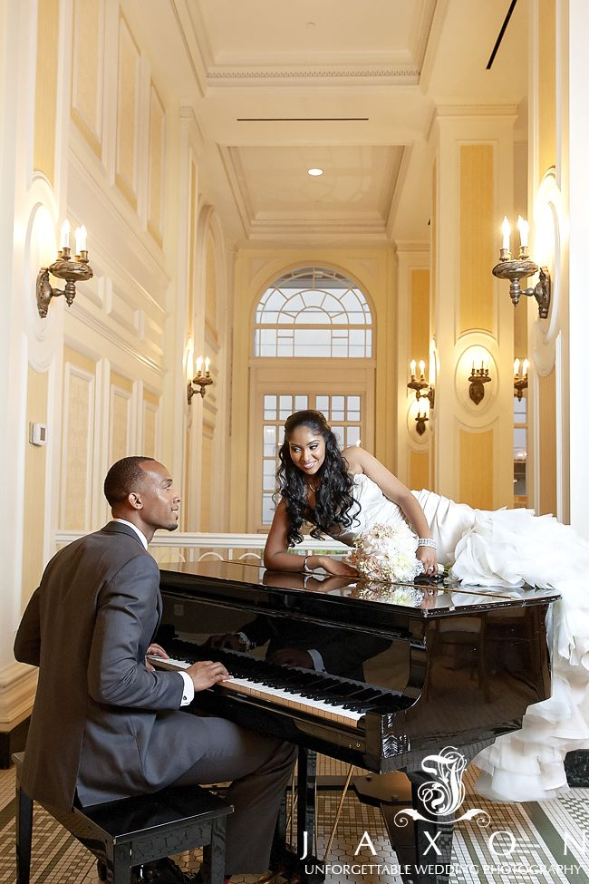 Groom plays his new bride a tune as she lays on Baby Grand Piano in the Piedmont Foyer
