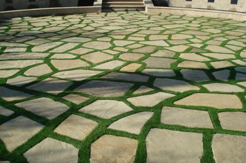 This crazy paved driveway along with artificial grass is a great finish to this driveway.
