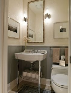 Great tall thin mirror flanked with sconces