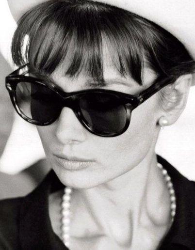 Audrey knew~bangs, shades, and pearls.