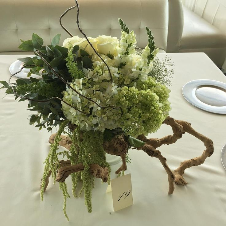Green hydrangea, roses and greenery rustic centerpiece