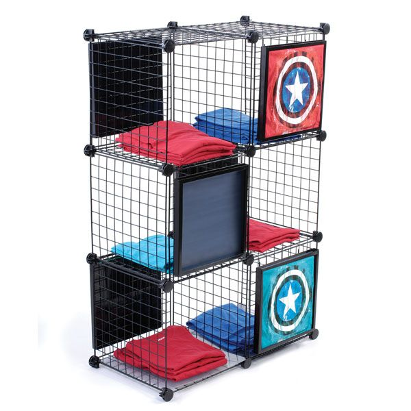 Cube T-Shirt Display. Mesh cubes are great for displaying and organizing your novelty t-shirts. Cube panels easily fit together with included connectors. Includes 6 metal t-shirt frames for displaying samples   Specialty Store Services