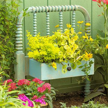 "old drawer attached to a bed footboard becomes an adorable ""window box"" planter"