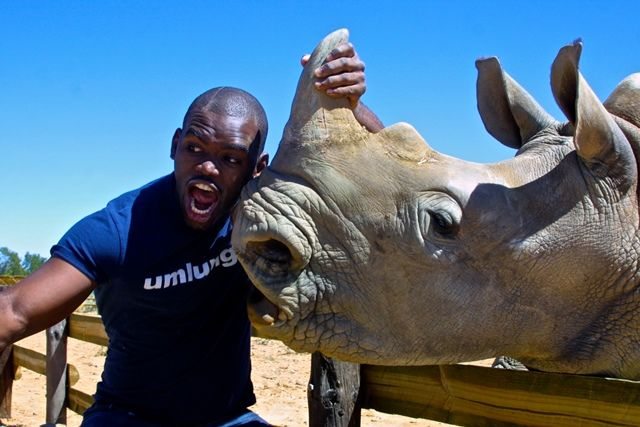 South African actor and comedian Siv Ngesi with Lavinia, a rescued baby rhino.