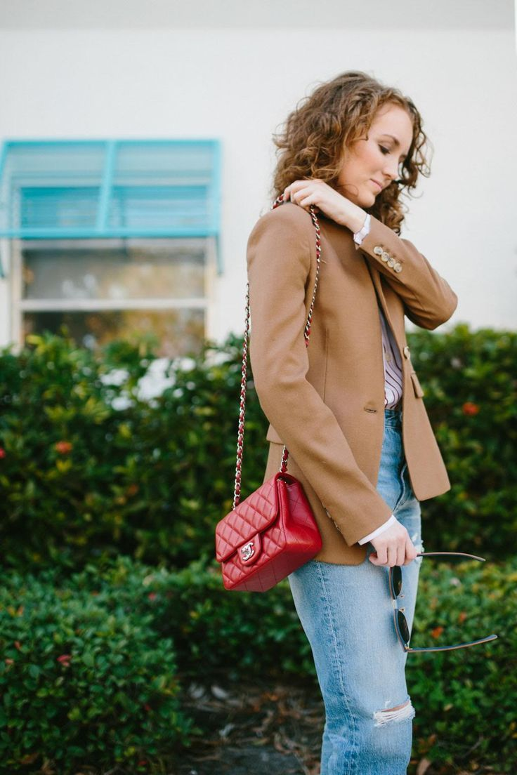 Brown blazer with jeans and a red Chanel purse