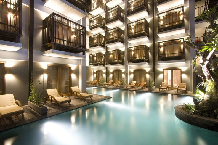 The lagoon pool with an evening ambiance at The Oasis Lagoon Sanur, Bali.