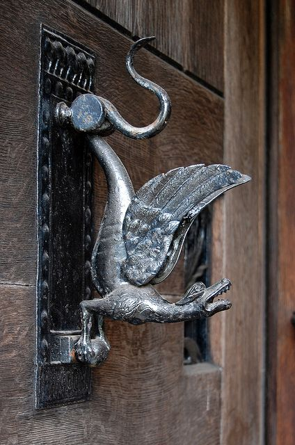 Dragon door knocker at Pownall Hall (school) just south of Manchester. The school was refurbished in lavish Arts and Crafts style in the 1880s by a member of the Boddington brewing family