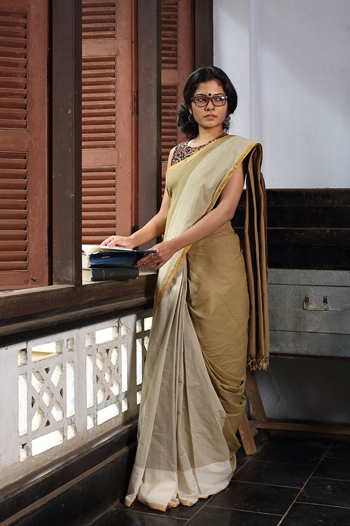 Offwhite, biscuit & olive come together in this beautiful unique sari. Edged with a dull gold border it is a study in contrast. Thinkers attire   THE KAI...