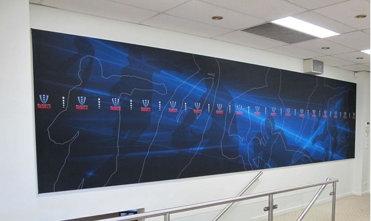 A large wall-mounted fabric banner frame in an office.